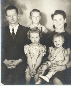 Joanne, Larry, Linda, Uncle John, Aunt Hilda.  Joanne is the very serious little girl in center of grouping.